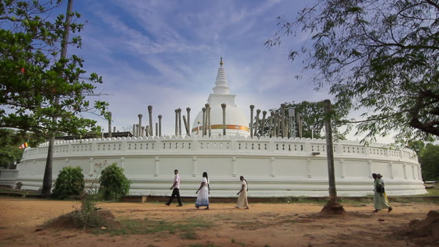 ms worshippers passing thuparama dagoba, the first dagaba built in sri lanka after introduction of buddhism, contains collarbone of buddha / anuradhapura, north central province, sri lanka - sri lankan culture stock videos & royalty-free footage