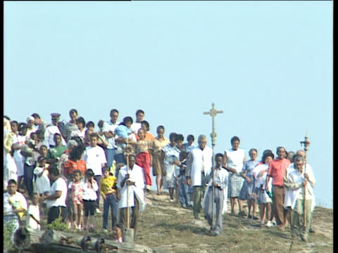 worshippers walk down hillside following leaders carrying crosses ouro preto brazil - preto stock videos & royalty-free footage