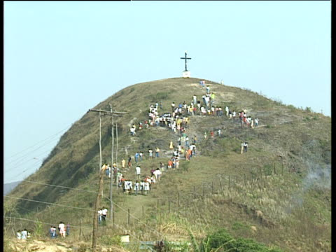 worshippers walking in line down hill from large cross on top ouro preto brazil - preto stock videos & royalty-free footage