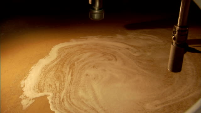 wort circulates in a stainless steel vat at a brewery. - vat stock videos & royalty-free footage