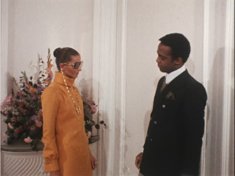 worth designer hylan booker checks an apricot coloured dress on a model - apricot stock videos & royalty-free footage