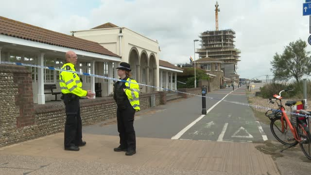 worthing beach closed after report of 'hazardous material'; england: west sussex: worthing: ext police vehicles parked various shots of police cars... - worthing点の映像素材/bロール