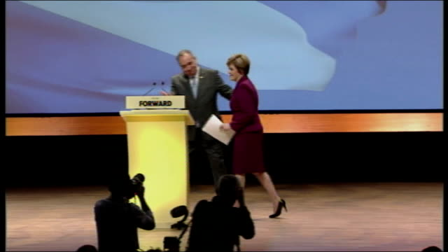 snp would cut fuel bills by 5% if independence vote passed scotland perth int nicola sturgeon msp along to podium at scottish national party... - scottish national party stock videos & royalty-free footage