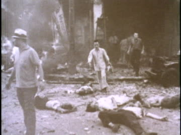 wounded and dead asians lie on the ground after a bomb explodes in front of the u.s. embassy in saigon in 1965. - gory of dead people stock videos & royalty-free footage