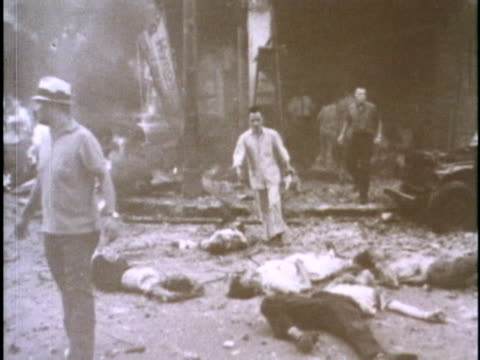 wounded and dead asians lie on the ground after a bomb explodes in front of the us embassy in saigon in 1965 - vietnam war stock videos & royalty-free footage
