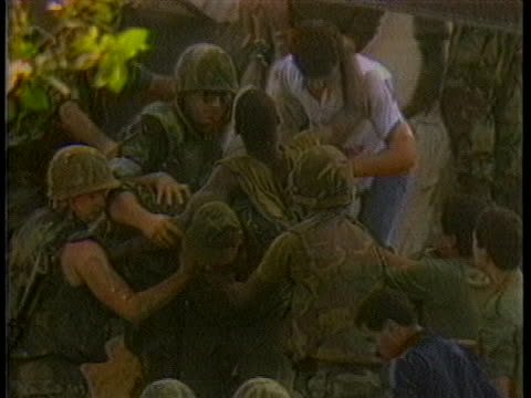 wounded soldier is rescued after the french headquarter bombing in beirut. - war or terrorism or military点の映像素材/bロール
