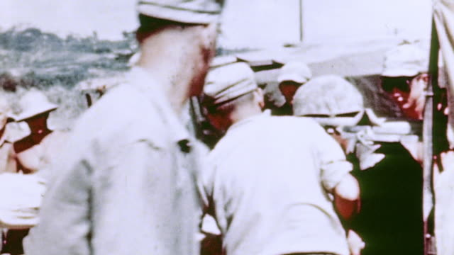 ts wounded soldier on a stretcher being unloaded from truck and carried away / naha okinawa japan - emt unloading stock videos & royalty-free footage
