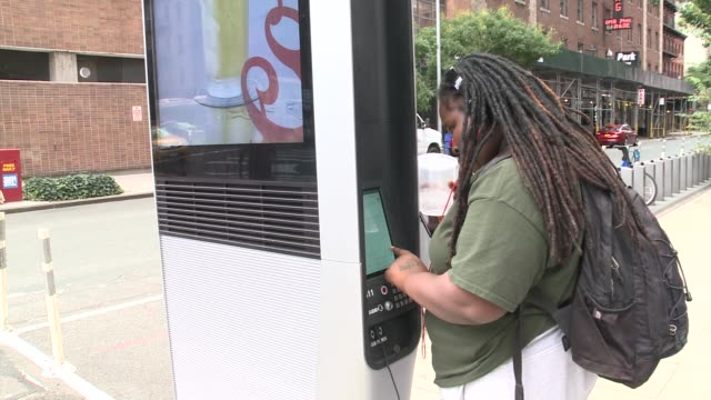 Woman uses Link NYC kiosk Link NYC Stations on September 12 2016 in New York City