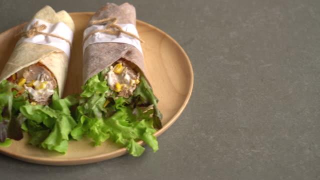 wrap salad roll with tuna corn salad - kebab stock videos and b-roll footage