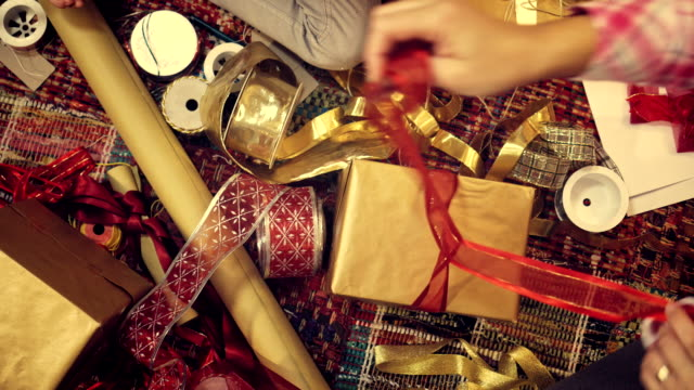 wrapping and decorating christmas presents - christmas gift stock videos & royalty-free footage