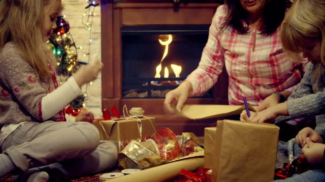 wrapping and decorating christmas presents - ornament stock videos and b-roll footage