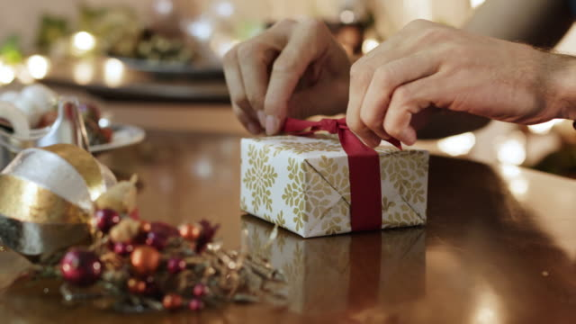 wrapping christmas gift - christmas stock videos & royalty-free footage
