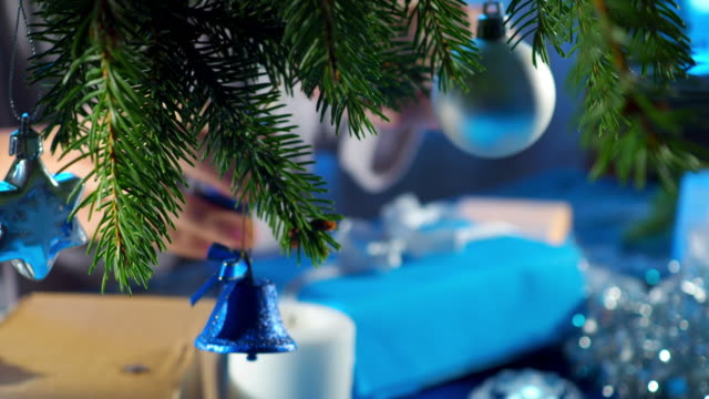 wrapping christmas presents in blue and silver - christmas wrapping paper stock videos & royalty-free footage