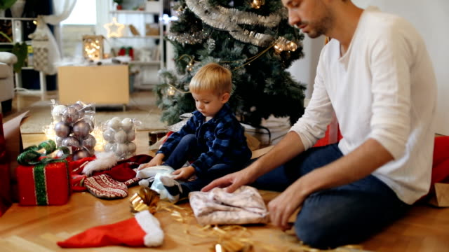 wrapping christmas presents - christmas gift stock videos & royalty-free footage