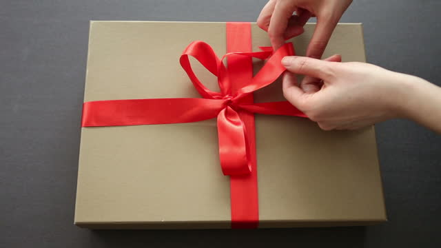 wrapping gift - tied bow stock videos & royalty-free footage