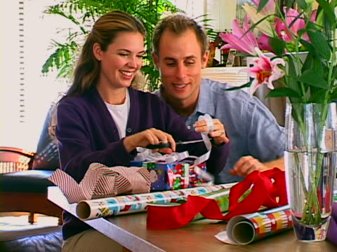 wrapping gifts - stargazer lily stock videos & royalty-free footage
