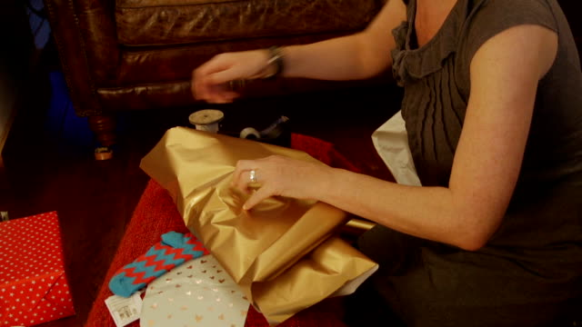wrapping up christmas presents - wrapping paper stock videos & royalty-free footage