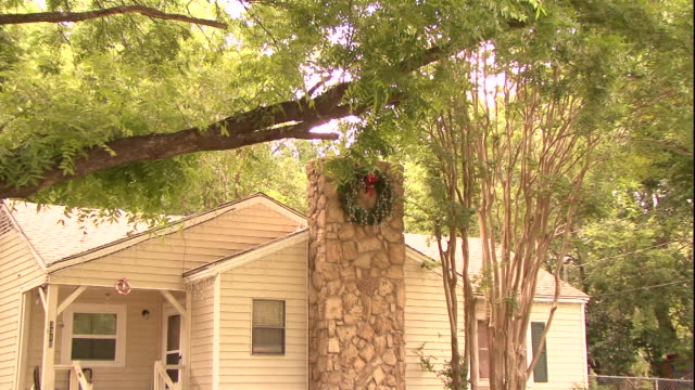 a wreath hangs from the chimney of a house in dallas. - wreath stock videos & royalty-free footage