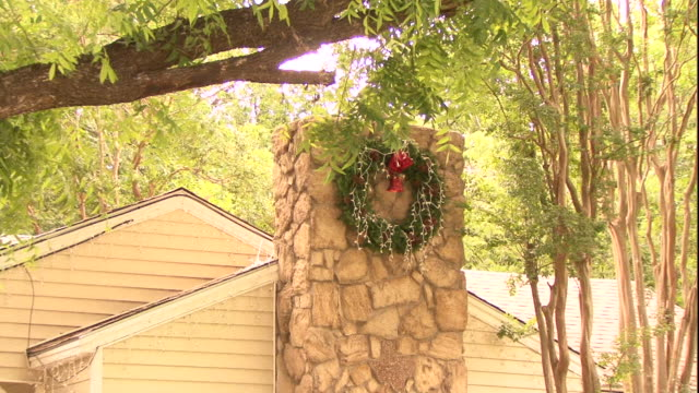 a wreath hangs on the chimney of a house. - wreath stock videos & royalty-free footage