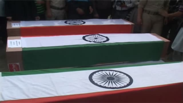 Wreath laying ceremony of three policemen killed by militants in two attacks in Srinagar of Indian Occupied Kashmir Three Indian policemen were shot...