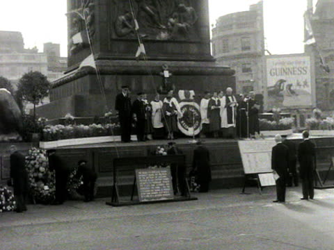 wreaths are laid at the base of nelson's column during the annual trafalgar day ceremony - nelson's column stock videos & royalty-free footage
