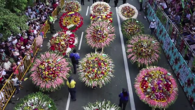 wreaths decorated with more than 50 varieties of flowers were carried by hundreds of people parading monday in medellin to celebrate the 60th... - medellin colombia stock videos & royalty-free footage