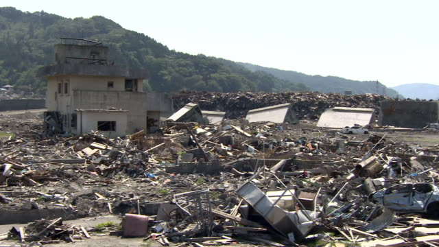wreckage covers an area devastated by a tsunami. - tsunami stock videos & royalty-free footage