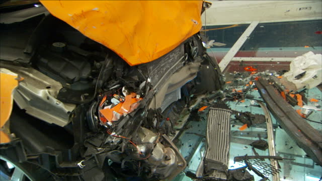 wreckage lies between two crashed vehicles in a crash-test facility. - crash test stock videos & royalty-free footage