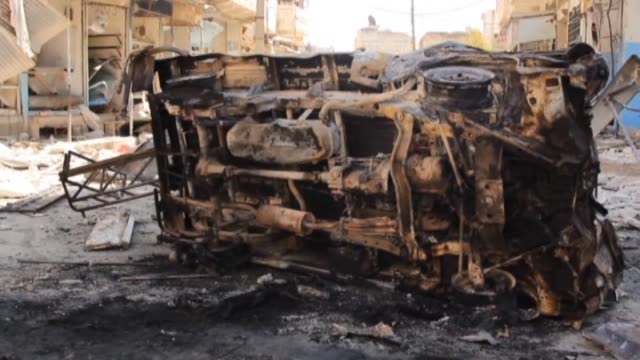 wreckage of cars and buildings destroyed after airstrikes staged by syrian regime forces are seen in idlib city northwestern syria on april 15 2015... - 武力攻撃点の映像素材/bロール