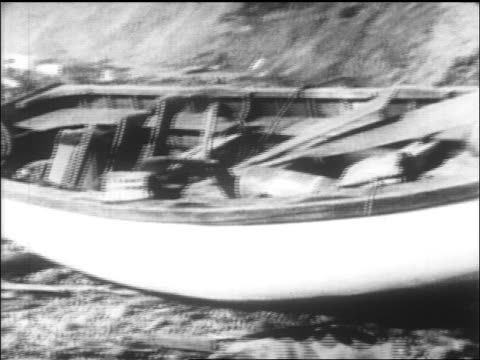 PAN wreckage of lifeboat from Lusitania on shore of Ireland / newsreel