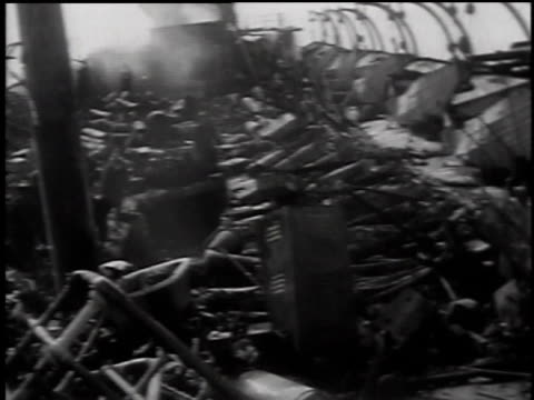 wreckage on board ship after fire / floating debris / rescue workers hauling body bags - 1949 stock videos & royalty-free footage