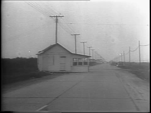 wreckage on cape may beach / montage of cleanup displaced homes on side of road - anno 1944 video stock e b–roll