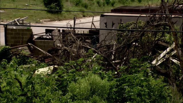 wreckage scattered around a field in the aftermath of hurricane katrina available in hd. - hurricane katrina stock videos and b-roll footage