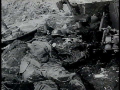 wrecked anti-tank gun & uniform of gunner in dirt. wrecked german tanks one w/ dead soldier on fire. dead german soldier's hand w/ swastika ring.... - tank stock videos & royalty-free footage