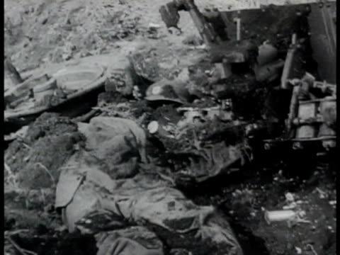 wrecked anti-tank gun & uniform of gunner in dirt. wrecked german tanks one w/ dead soldier on fire. dead german soldier's hand w/ swastika ring.... - russia stock videos & royalty-free footage