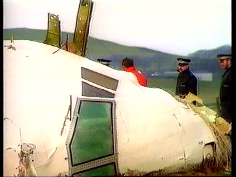 evidence lib wrecked cockpit of aircraft laying in field with police around cms ditto cms part of wrecked cockpit pull air view wreckage of cockpit - lockerbie stock videos & royalty-free footage
