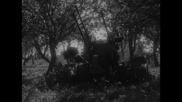 wrecked german tanks / vs captured german artillery / two shots of captured german rocket launchers / four shots of captured german ammunition /... - kampfpanzer stock-videos und b-roll-filmmaterial