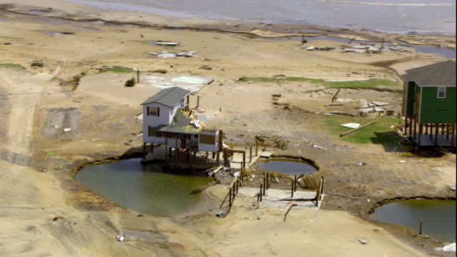 ws zi zo pov aerial wrecked house on beach / gilchrist, texas, usa - hurrikan stock-videos und b-roll-filmmaterial