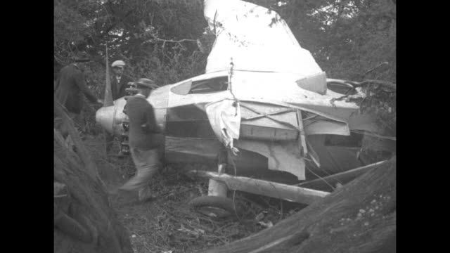 Wrecked plane lying on ground / wider shot of man riding horse past wreckage / two shots of men examining wrecked plane/ US Army planes flying in...