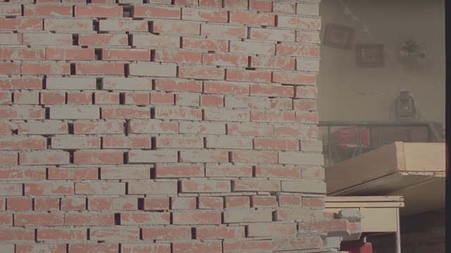 wrecking ball smashes into side of brick building - brick stock videos & royalty-free footage