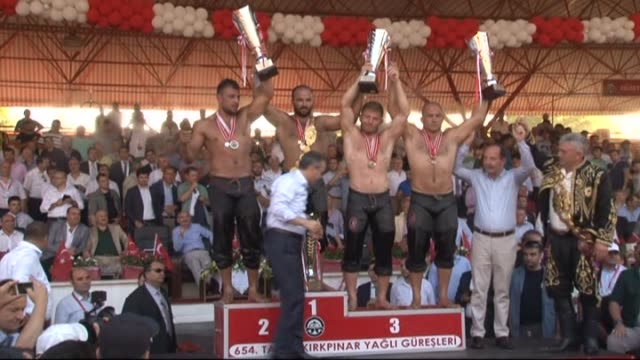 wrestler orhan okulu wins the competition against osman aynur during the final competition of 654th annual kirkpinar oil wrestling festival in edirne... - bubble bath stock videos & royalty-free footage
