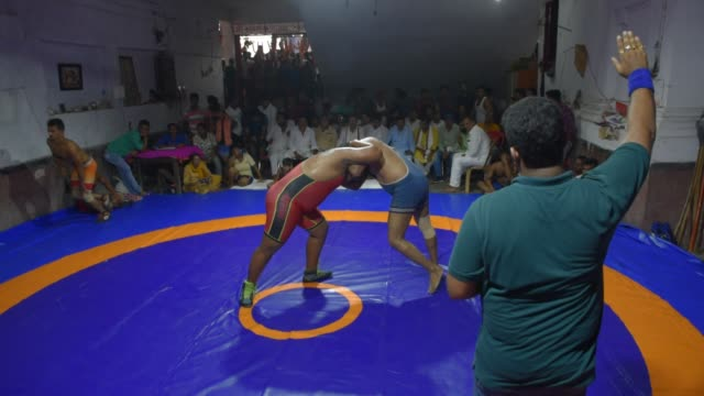 wrestlers compete for a local kushti competition in kolkata india 18 october 2019 kushti is a traditional sport in india - traditional sport stock videos & royalty-free footage