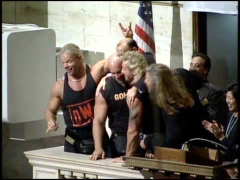 vidéos et rushes de wcw wrestlers ring opening bell at the nyse - manhattan