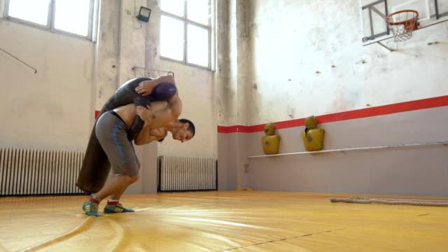 レスリングの修行 - 格闘技リング点の映像素材/bロール