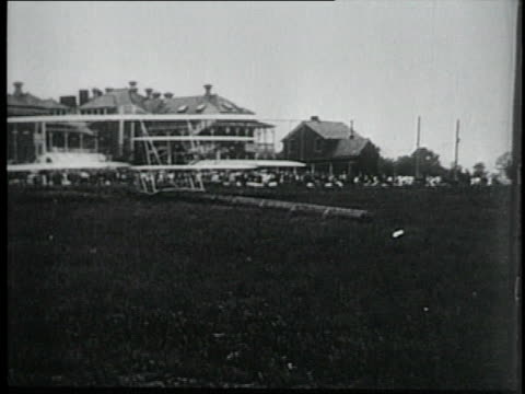 wright brothers' airplane taking flight in us army demonstration / fort myer virginia united states - fort myer stock videos and b-roll footage