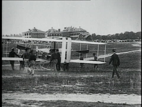 wright brothers and crew bringing their airplane out of a barn and starting the engine for us army demonstration / fort myer virginia united states - fort myer stock videos and b-roll footage