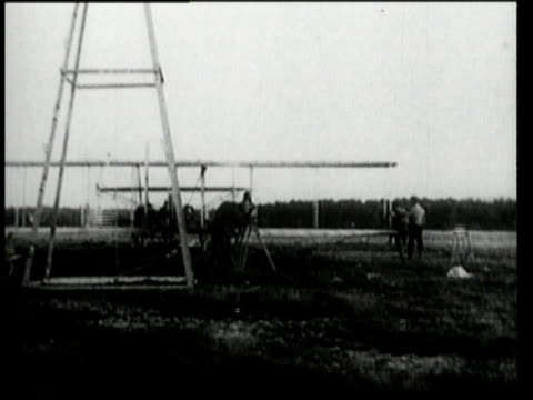 Wright Brothers watch very early biplane flight / Ohio United States
