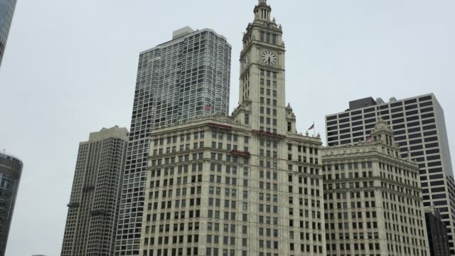 wrigley clock tower beside chicago river in downtown of chicago, illinois, usa - clock tower stock videos & royalty-free footage