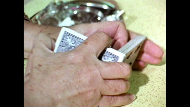 cu of wrinkled hands playing poker at table; 1969 - playing card stock videos & royalty-free footage