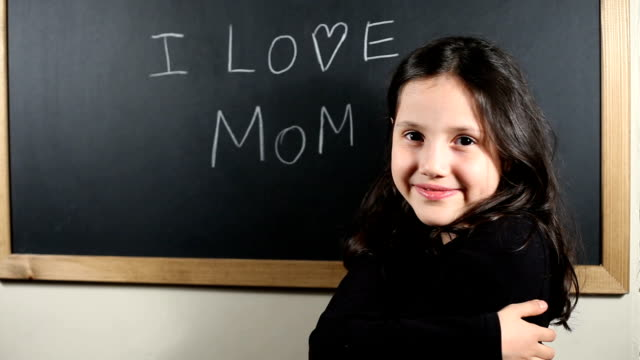 "Write ""I Love Mom"" on the blackboard"